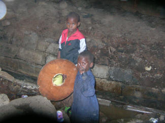 Children playing in the sewage of the Mathare slums